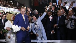 Turkish President Recep Tayyip Erdogan (C-R) and his wife Emine (L) greet supporters of the ruling Justice and Development Party (AKP), during an extraordinary congress, in Ankara, Turkey, 21 May 2017. AKP held an extraordinary congress on 21 May where President Recep Tayyip Erdogan is expected to regain his party leadership and announce the party's new action plan for the 2019 elections, according to local media. EPA/TUMAY BERKIN
