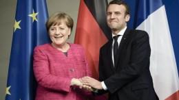 FILE PHOTO. German Chancellor Angela Merkel (L) and newly elected French President Emmanuel Macron (R). EPA/CLEMENS BILAN