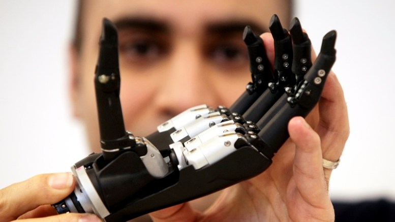Dr. Kianoush Nazarpour from Newcastle University's Biomedical Engineering department pictured with the newly developed 'multi-functional prosthetic hand'. Pic: Mike Urwin. 230215