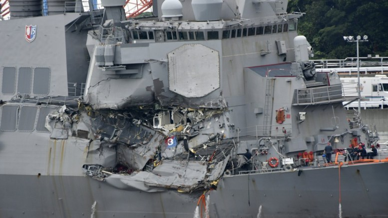 FILE PHOTO. The damaged US Navy destroyer USS Fitzgerald is seen berthing at Yokosuka Naval Base in Yokosuka, south of Tokyo, Japan, 18 June 2017. Media reports state that seven US Navy sailors were found dead earlier in the day in the destroyer after it collided with the container ship ACX Crystal off the coast of Yokosuka on 17 June. EPA/FRANCK ROBICHON