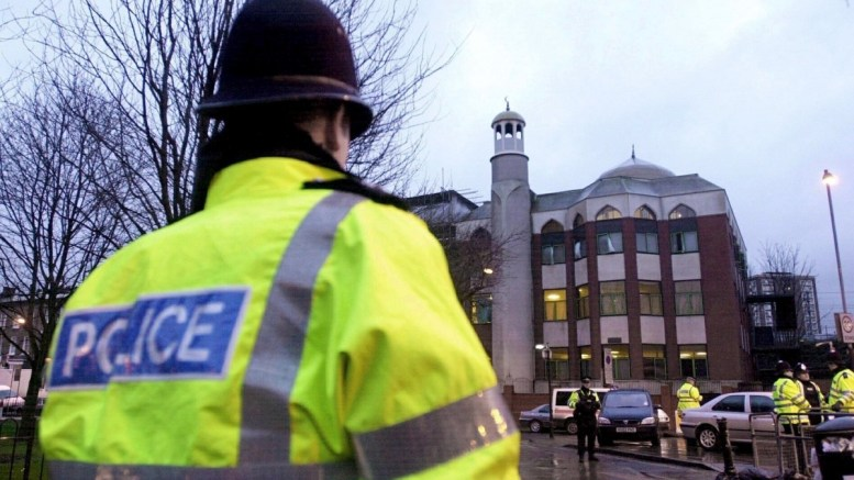 A police officer stands in front of Finsbury Park Mosque in north London, Britain, 20 January 2003. According to the Metropolitan Police Service, police responded on 19 June 2017, to reports of a major incident where a vehicle collided with pedestrians in Seven Sisters Road, in north London. EPA/NICOLAS ASFOURI