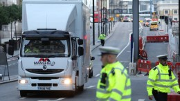 A specialist truck loaded with the van used for a terror attack is driven away from London Bridge, the day after the attacks, London. EPA/ANDRE PAIN