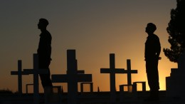 FILE PHOTO. Cypriot soldiers stand next to crosses marking the graves of Greek and Cypriot soldiers killed in the 1974 Turkish invasion of Cyprus, at the Tymvos Macedonitissas military cemetery in Nicosia, Cyprus, 19 July 2017. The date of 20 July 2017 marks the 43nd anniversary of the Turkish invasion of Cyprus. In 1974, Cyprus was split into Greek Cypriot south and Turkish Cypriot north when Turkey invaded in response to a coup by supporters of union with Greece. EPA, KATIA CHRISTODOULOU