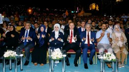 A handout photo made available by the Turkish Presidental Press Office shows Turkish President Recep Tayyip Erdogan (C-R), his wife Emine Erdogan (C-L), Turkish Prime Minister Binali Yildirim (2-R) praying during a rally for the first anniversary of the failed coup attempt on Bosphorus Bridge in Istanbul, Turkey, 15 July 2017. The 15 July 2017 event marks the first anniversary of the failed coup attempt which led to some 50,000 workers being dismissed, some 8,000 people arrested, and scores of news outlets shut down by the government. Turkish President Recep Tayyip Erdogan blamed US-based Turkish cleric Fetullah Gulen and his movement for masterminding the failed coup and Turkey remains under a state of emergency as a result. EPA, PRESIDENTAL PRESS OFFICE HANDOUT, EDITORIAL USE ONLY