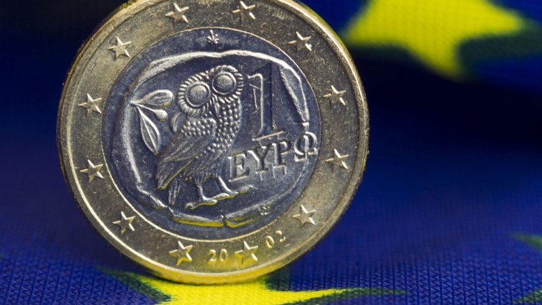An illustration showing a Greek euro coin on a European flag in Schwerin, Germany. Φωτογραφία Αρχείου  EPA, JENS BUETTNER