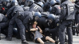 FILE PHOTO.  Protesters clash with German police officers during the G-20 summit in Hamburg, Germany, 07 July 2017. The G20 Summit (or G-20 or Group of Twenty) is an international forum for governments from 20 major economies. The summit is taking place in Hamburg 07 to 08 July 2017. EPA/MASSIMO PERCOSSI