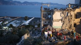 Rescuers at work amid the rubble of a building that collapsed in Torre Annunziata, near Naples, southern Italy, 07 July 2017. Torre Annunziata Mayor Vincenzo Ascione said seven people were missing, including two children, after an apartment building collapsed in the southern city near Naples. EPA/CESARE ABBATE