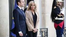 French President Emmanuel Macron and his wife Brigitte Macron at the Elysee Palace in Paris. EPA/ETIENNE LAURENT