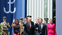 President of Poland Andrzej Duda (2-R) and US President Donald J. Trump (2-L) with Polish First Lady Agata Kornhauser-Duda (R), and US First Lady Melania Trump (L) greet crowds after Trump's speech at Krasinski Square, Warsaw, Poland, 06 July 2017. Trump is on an official visit to Poland. EPA/PAWEL SUPERNAK POLAND OUT