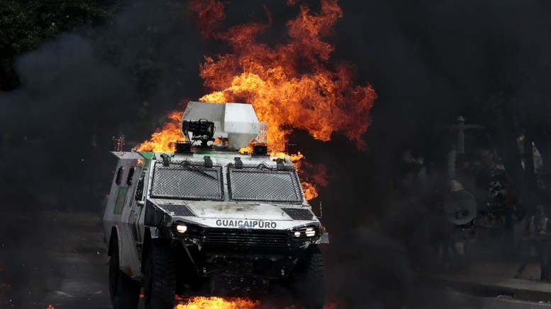 FILE PHOTO. A Bolivarian National Guard is engulfed in flames during a clash between opposition protesters and the Bolivarian National Guard in Barquisimeto, Venezuela, 30 July 2017. Clashes broke out as the voting on a constituent assembly took place under strict security measures and despite the rejection of local opposition and the international community. The new assembly would have powers to rewrite a constitution and bypass the National Assembly which is currently controlled by the opposition. EPA/PASCUALE GIORGIO