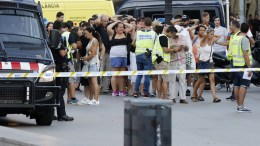 Police officers set up a security perimeter and identify people near the site where a van crashes into pedestrians in Las Ramblas, downtown Barcelona, northeaster Spain, 17 August 2017. At least 13 people have died in the terrorist attack. EPA, Andreu Dalmau FACES PIXELATED BY SOURCE DUE TO SPANISH LAW