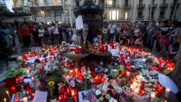 FILE PHOTO. People pay tribute to victims in Canaletas square, in Barcelona, Spain, 18 August 2017. According to media reports, at least 14 people have died and 130 were injured when a van crashed into pedestrians in Las Ramblas, downtown Barcelona in an incident which Spanish police are treating as a terror attack. EPA, QUIQUE GARCIA