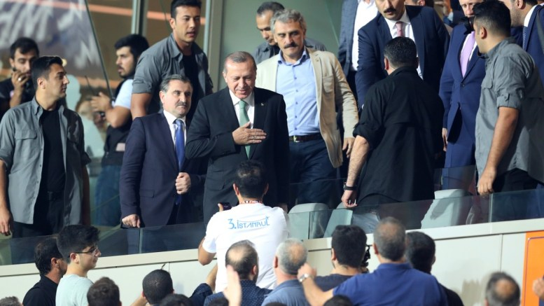 Turkish President Recep Tayyip Erdogan (C) at the stadium for the UEFA Champions League third qualifying round second leg match between Basaksehir Istanbul and Club Brugge in Istanbul, Turkey. EPA, TOLGA BOZOGLU