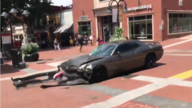A video grab made available by Brennan Gilmore? shows a car reversing after hitting a crowd in Charlottesville, Virginia, USA, 12 August 2017. According to media reports at least one person was killed after a car hit a crowd of people counter-protesting the 'Unite the Right' rally which was scheduled to take place in Charlottesville on 12 August. EPA, BRENNAN GILMOREHANDOUT, EDITORIAL USE ONLY