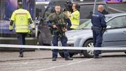 FILE PHOTO. Police officers gather at the site of a multiple stabbing on the Market Square in Turku, Finland. EPA/STRINGER FINALND OUT