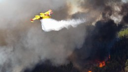 FILE PHOTO. A plane drops water over a forest fire at Bracal, Abrantes, central Portugal, 11 August 2017. More than 670 firemen, 213 land vehicles and seven helicopters and airplanes combat this forest fire. EPA, PAULO CUNHA