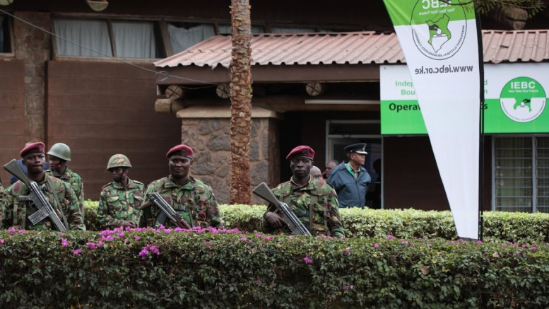 Kenya police officers stand guard as Kenyans await on the announcement of the final presidential results at Bomas of Kenya where the national tallying centre for Independent Electoral and Boundaries Commission (IEBC) are located in Nairobi. EPA/DANIEL IRUNGU