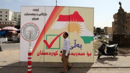 A man walks next to a poster for the referendum to call the Kurds to vote for independence at the old city of Erbil, Kurdistan region in northern Iraq, 24 September 2017. The Kurdistan region is an autonomous region in northern Iraq since 1991, with an estimated population of 5.3 million people. On 25 September the Kurdistan region holds a referendum for independence and the creation of the state of Kurdistan amidst divided international support. EPA, MOHAMED MESSARA