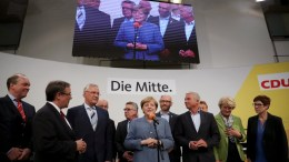 German Chancellor Angela Merkel (C) of the Christian Democratic Union (CDU) speaks to her supporters late in the evening at the CDU election event in Berlin, Germany, 24 September 2017. EPA, CARSTEN KOALL