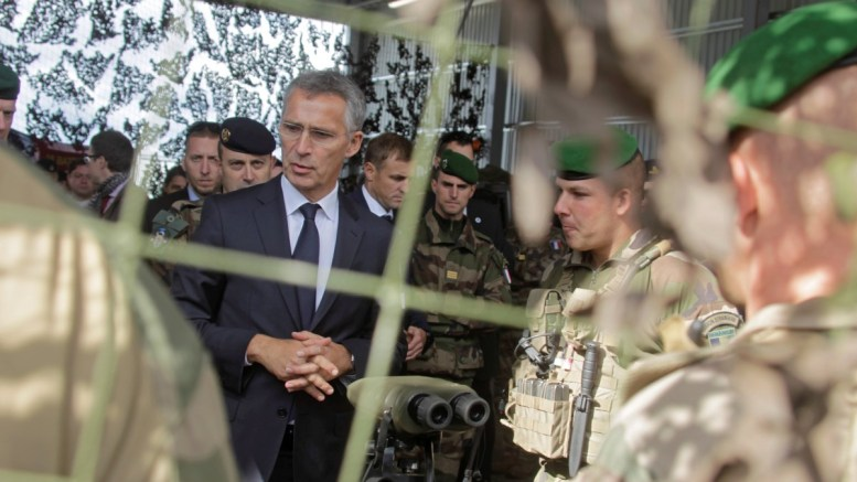 NATO Secretary General Jens Stoltenberg (C) speaks with French troops during a visit to Estonian Defence Forces 1st Infantry Brigade and NATO enhanced Forward Presence Battle Group located in Tapa, Estonia. EPA, Valda Kalnina
