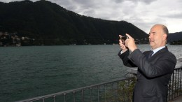 European Economic Affairs Commissioner Pierre Moscovici takes a photo of the scenery as he attends the forum 'The Today and Tomorrow's Competitive Strategies' organized by 'The European House - Ambrosetti' at Villa d'Este in Cernobbio, Italy, 02 September 2017. The 43rd edition of the meeting takes place from 01 to 03 September 2017.  EPA/MATTEO BAZZI