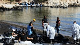 Workers, members of a clean-up crew, struggle to remove an oil spill from the sea, near the site where a tanker sank off the island of Salamina, Athens, Greece, 22 September 2017. The pollution comes from the small tanker ship 'Agia Zoni II' that sank on 10 September while anchoring off the coast of Salamina, near Greece's main port of Piraeus, with a cargo of 2,200 tons of fuel oil and 370 tons of marine fuel oil on board. The sinking of the 'Agia Zoni II' caused a major oil spill in the Saronic Gulf, which could not be contained before it had spread to the island of Salamina, the coastal suburbs of Piraeus and a significant stretch of the Athens 'Riviera' on the southern coast of Attica.  EPA/PANTELIS SAITAS