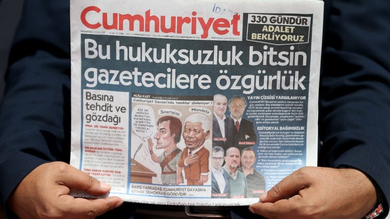 FILE PHOTO. A man hold a copy of the Cumhuriyet newspaper. EPA, ERDEM SAHIN