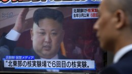 A pedestrian walks past a TV screen on a street displaying North Korean leader Kim Jong-un after North Korea proceeded to a nuclear test, in Tokyo, Japan, 03 September 2017. North Korea announced it has conducted to its sixth nuclear test by detonating a hydrogen bomb that can installed in an ICBM. EPA/FRANCK ROBICHON