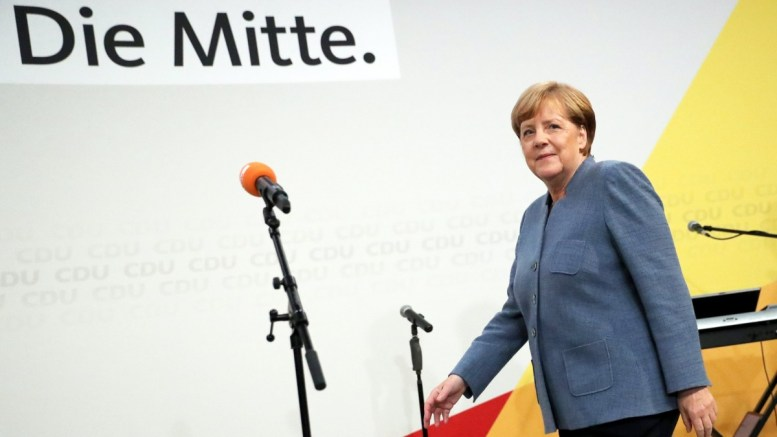 German Chancellor Angela Merkel of the Christian Democratic Union (CDU) steps on a stage in the late evening at the CDU election event in Berlin, Germany, 24 September 2017. According to federal election commissioner more than 61 million people were eligible to vote in the elections for a new federal parliament, the Bundestag, in Germany. EPA/CARSTEN KOALL
