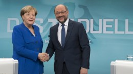 FILE PHOTO: German Chancellor Angela Merkel (L) of the Christian Democratic Union (CDU) and Martin Schulz (R). EPA, HERBY SACHS WDR / POOL