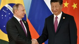 Chinese President Xi Jinping (R) and Russian President Vladimir Putin shake hands before the group photo at 2017 BRICS Summit in Xiamen, Fujian province, China, 04 September 2017. The ninth BRICS (Brazil, Russia, India, China and South Africa) Summit in Xiamen runs from 03 to 05 September.  EPA/KENZABURO FUKUHARA / POOL