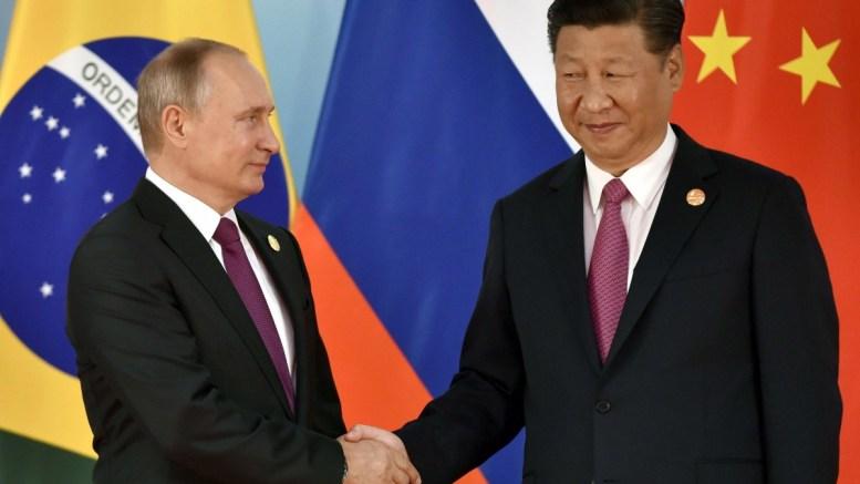 Chinese President Xi Jinping (R) and Russian President Vladimir Putin shake hands before the group photo at 2017 BRICS Summit in Xiamen, Fujian province, China, 04 September 2017. The ninth BRICS (Brazil, Russia, India, China and South Africa) Summit in Xiamen runs from 03 to 05 September.  EPA/KENZABURO FUKUHARA / POOL