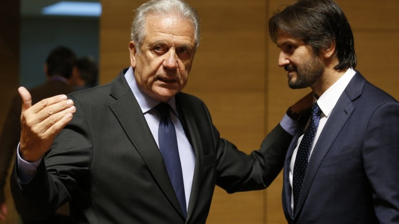 EU Commissioner for Migration, Home Affairs and Citizenship, Dimitris Avramopoulos (L) chats with Slovak Interior Minister Robert Kalinak (R) at the start of the Joint Justice and Home Affairs Council meeting in Luxembourg, 13 October 2017.  There will be a Proposal for a regulation amending the Schengen Borders code.  EPA/JULIEN WARNAND