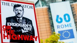 File Photo: A Kurdish protester holds banner of Turkish President Reicep Erdogan dressed as Adolph Hitler during a demonstration against the violence by Iraqi, Iranian, and Shia PMF militias on Kurdistan and the passive attitude of the European Union, in front of the European Commission and European Council in Brussels, Belgium. EPA, STEPHANIE LECOCQ