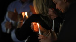 People light candles during a candlelight vigil for all those affected by the mass shooting at the Route 91 Harvest Festival on Las Vegas Boulevard at Mountain Crest Park in Las Vegas, Nevada, USA, 03 October 2017. Over a hundred people attended the vigil where a candle was lit for every victim of the Las Vegas shooting. Police reports indicate that a gunman, identified as Stephen Paddock, 64, firing from an upper floor in the Mandalay Bay hotel killed 58 people and injured more than 500 before he reportedly killed himself as police made their way to his hotel room. EPA, PAUL BUCK