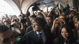Catalan dismissed President, Carles Puigdemont (C), next to his wife, Marcela Topor (CR), greets supporters as he leaves a restaurant in Vi square, Girona (Catalonia, northeastern Spain), 28 October 2017. Puigdemont offered a speech earlier today after Spanish Government removed him from post the previous day as part of the package of initiatives applied in observance to the Spanish Constitution's 155 Article. Puigdemont said that he does not acknowledge his dismissal as Catalan President and asked Catalans to have 'patience, persistance and perspective' to 'defend the conquests achieved up to now'.  EPA/MARTA PEREZ