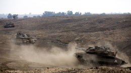 FILE PNOTO. Israeli Merkava tanks train at the Golan Heights area, on the Israeli-Syrian border. EPA, ATEF SAFADI