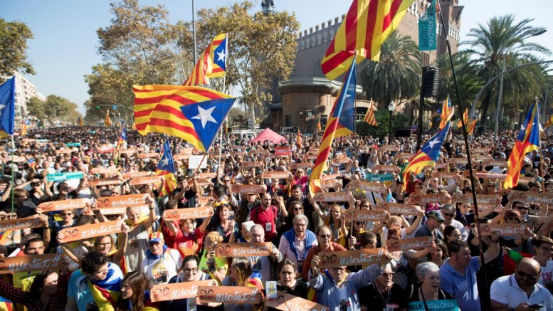 FILE PHOTO. Pro-independence protesters shout slogans as they gather in the surroundings of the Catalan regional Parliament to show their support to a possible independence proclamation. EPA/MARTA PEREZ