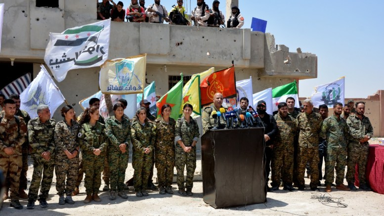 FILE PHOTO. The spokesman for Syrian Democratic Forces (SDF) (C) speaks during a press conference in the village of Al-Hazeema northern the city of Raqqa ,Syria. EPA, YOUSSEF RABIE YOUSSEF