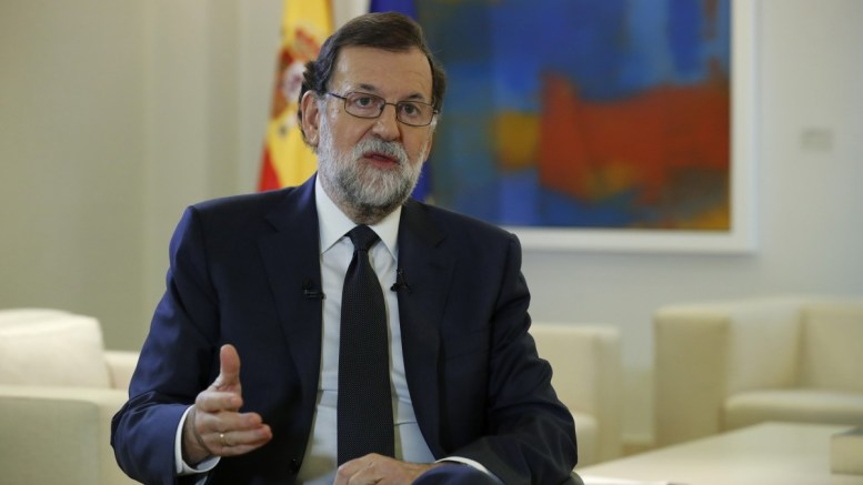 FILE PHOTO. Spanish Prime Minister Mariano Rajoy gestures while speaking during an interview. EPA/ANGEL DIAZ