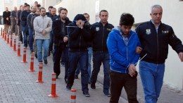 FILE PHOTO. Members of the Turkish police escort suspects during nationwide operation. EPA/OLCAY DUZGUN TURKEY OUT