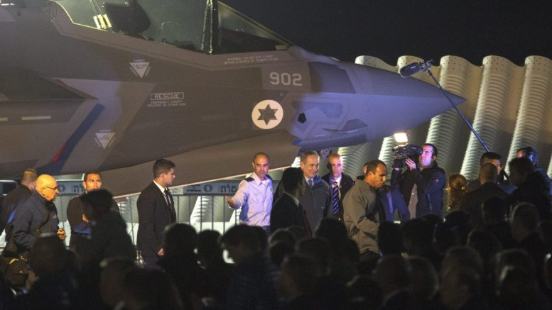 FILE PHOTO. Israeli Prime Minister Benjamin Netanyahu (C-R), accompanied by the Commander of the Israeli Air Force Maj. Gen. Amir Eshel (C-L) on Nevatim Air Force Base in the Negev desert, after he placed an Israeli Star of David decal on one of the two newly arrived F-35 Adir jet fighters. EPA/JIM HOLLANDER