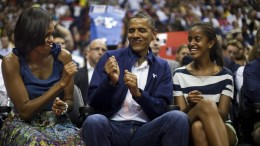 A file picture shows US President Barack Obama (C) does a little dance while First Lady Michelle Obama (L) and the President's daughter Malia (R) look on as they attend an exhibition basketball game between the USA and Brazil at the Verizon Center in Washington DC, USA. EPA, JIM LO SCALZO