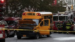 A school bus sit in the street at the crime scene in downtown New York, New York, USA, 31 October 2017. Eight people were killed in the incident, and at least 11 were injured when the driver of a pickup truck ran pedestrians and bicyclists down in a bike lane. He then collided with the school bus injuring several people including two children in the bus. The driver was taken into custody after being shot by police. The incident is being investigated as a terror attack. EPA/JASON SZENES