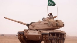 A handout photograph released by the official Saudi Press Agency (SPA) shows a soldier saluting atop a Saudi tank. EPA, SAUDI PRESS AGENCY / HANDOUT EDITORIAL USE ONLY