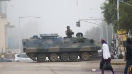 An army tanker blocks the main road to Parliament building in Harare, Zimbabwe, 15 November 2017, to prevent members of the public from passing through. The Zimbabwe National Army (ZNA) has reportedly taken control over the government of President Robert Mugabe. The army seized the national broadcaster's headquarters (ZBC) on 14 November night, to announce that President Mugabe and his family were safe but without citing their whereabouts. The military denied it staged a coup d'etat. EPA/AARON UFUMELI