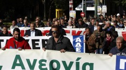 FILE PHOTO: Protesters hold banners and shout slogans during a 24-hour general strike, in Athens, Greece. EPA, ALEXANDROS VLACHOS