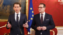 Austrian Peoples Party (OeVP) Sebastian Kurz (L) and leader of the right-wing Austrian Freedom Party (FPOe) Heinz-Christian Strache (R) during a press conference. EPA/FLORIAN WIESER