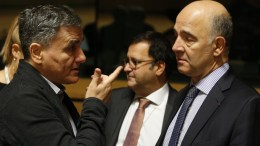FILE PHOTO: Greek Finance Minister Euclid Tsakalotos talks to European Commissioner for Economic and Financial Affairs, Taxation and Customs Pierre Moscovici. EPA, JULIEN WARNAND