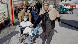 An Afghan man who was injured in a suicide bomb attack is rushed for first aid in Kabul, Afghanistan, 27 January 2018. A huge explosion rocked Kabul on 27 January, killing at least 103 people and injuring several dozens people.  EPA/HEDAYATULLAH AMID